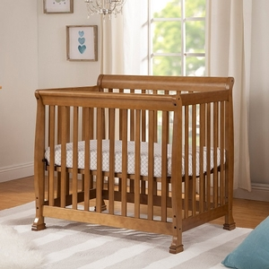 006MCRB Slatted Mini Sleigh Crib in Chestnut - Finish: Chestnut<br><br>Available in White, Ebony Black, Grey & Espresso<br><br>Made in Taiwan<br><br>Assembly Required<br><br>Dimensions: 40