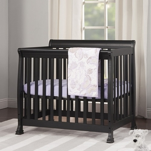 018MCRB Slatted Mini Sleigh Crib in Ebony Black - Finish: Ebony Black<br><br>Available in White, Chestnut, Grey & Espresso<br><br>Made in Taiwan<br><br>Assembly Required<br><br>Dimensions: 40