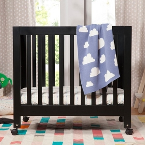 009MCRB Portable Mini Crib in Black - Finish: Black<br><br>Available in Grey, Lagoon, Petal Pink, Washed Natural & White<br><br>Made in China<br><br>Assembly Required<br><br>Dimensions: 38.625