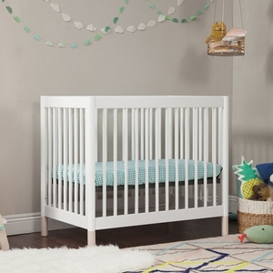 005MCRB Mini Crib w/ Interchangeable Feet - Finish: White/Natural<br><br>Available in Washed Natural/White<br><br>Made in Taiwan<br><br>Assembly Required<br><br>Dimensions: 39.75