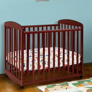 008MCRB Mini Rocking Crib in Cherry - Finish: Cherry<br><br>Available in Ebony Black, Slate, Natural & White<br><br>Made in China<br><br>Assembly Required<br><br>Dimensions: 38.75