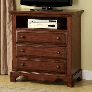029MCH Media Chest - This classic styled group is crafted with solid woods and veneer in a distressed light walnut finish, featuring antique gold finish knobs and multiple drawers for plenty of storage.